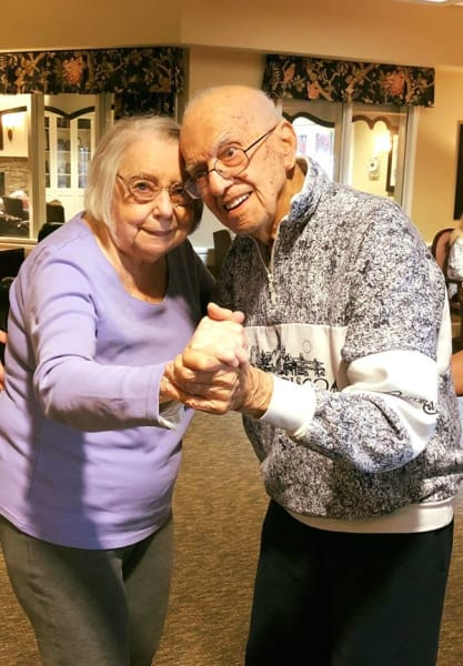 elderly couple dancing together on their 69th wedding anniversary