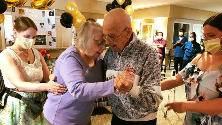 senior couple dancing together to celebrate their 69th wedding anniversary